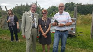 Bob Slee, secretary of the allotments association, with one of the prizes