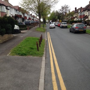 The extended yellow lines at the bottom of Downside Road